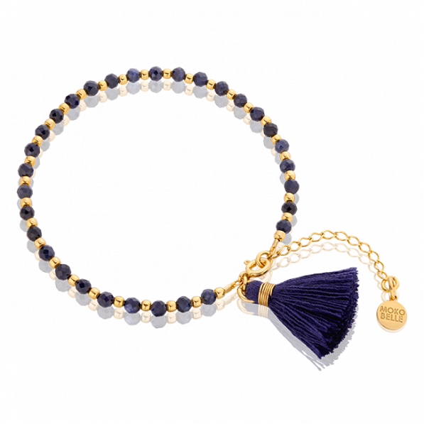 Bracelet with sapphires and gold-plated beads with a navy blue tassel